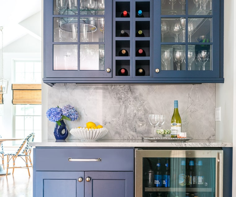 kitchen coffee bar with blue cabinets and grey stone backsplash